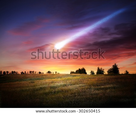 Meteorite and Earth. Elements of this image furnished by NASA. - stock photo