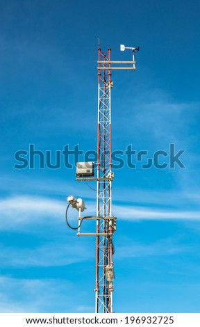 Meteorological sensors of weather station under blue sky  - stock photo