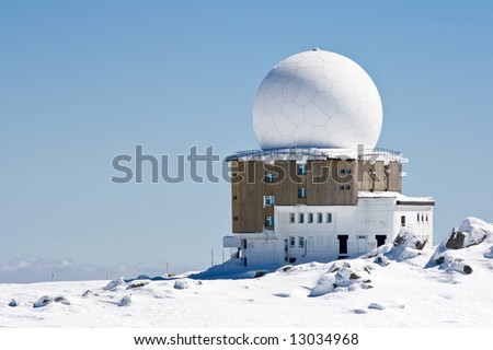 meteorological station high in the mountain - stock photo