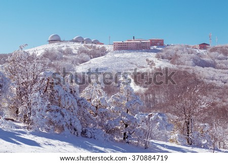 meteorological station high in the mountain in the winter - stock photo