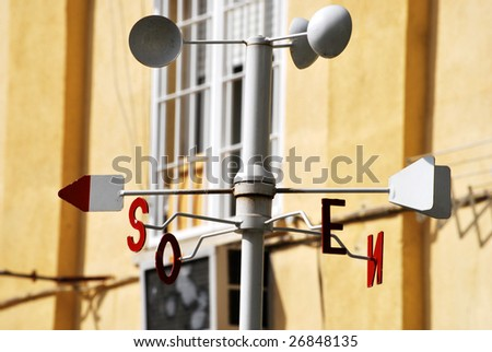Meteorological station with a vane and an anemometer - stock photo