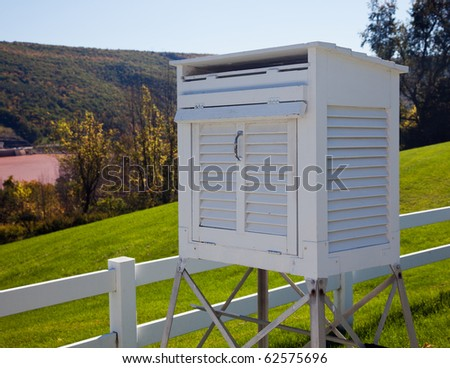 Meteorology equipment in white measuring container - stock photo