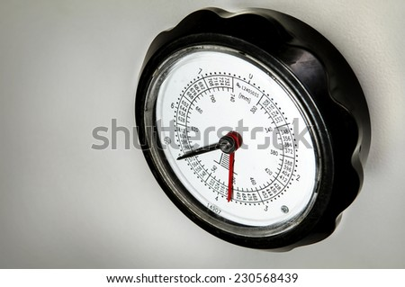 meter in the printing machine in printing house - stock photo