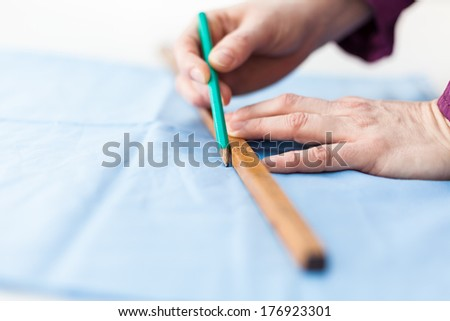 Metering tissue with a wooden dip stick - stock photo