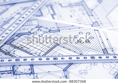 metric folding ruler and architectural drawings of the modern house