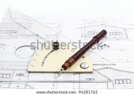 metric ruler and pen over a architectural drawings. - stock photo
