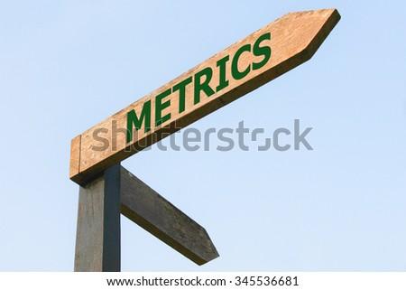 METRICS word on wood roadsign - stock photo