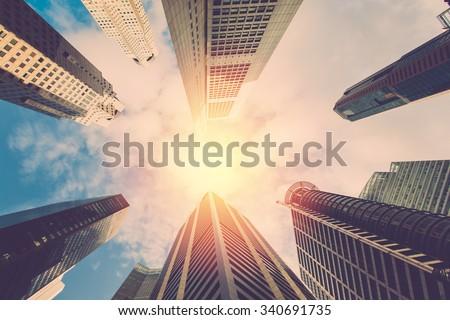 Metro city. High building on sky in Singapore. retro filter. - stock photo