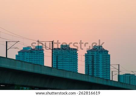 Metro on sunset sky background. - stock photo