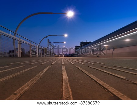 Metro passing a station at night - stock photo