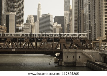 Metro passing over the river - stock photo