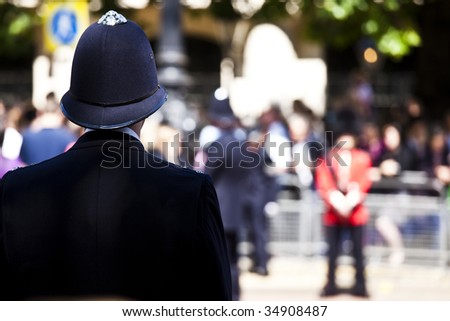 Metro policeman and queen?s guard face off - stock photo