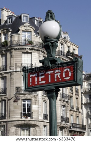 Metro Sign And Street Lamp In Paris, Typical Parisienne Building Facade - stock photo