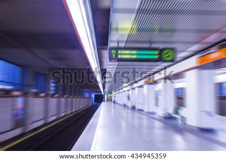 metro station,subway station with people passing by  - stock photo