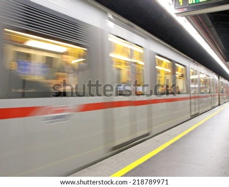 Metro station with the train that runs fast - stock photo
