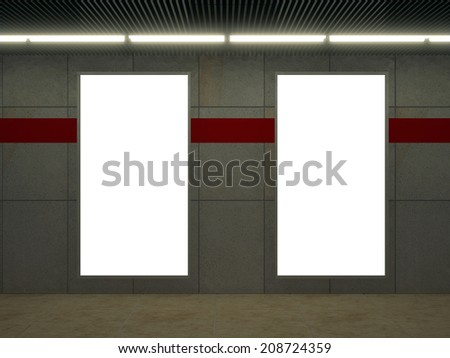 Metro station with white tile wall and empty ad space.