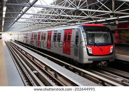 Metro train at the subway station - stock photo