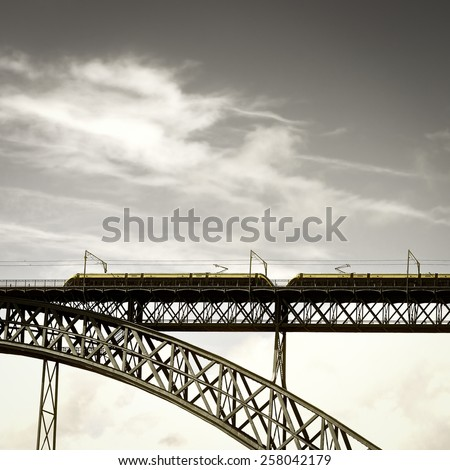 Metro Train on the Bridge Built by Eiffel in Porto, Vintage Style Toned Picture - stock photo