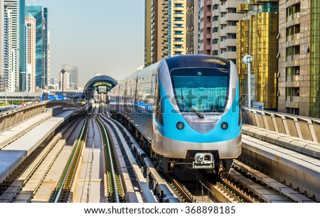 Metro train on the Red line in Dubai - stock photo
