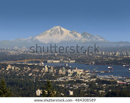 METRO VANCOUVER - SEPT.12, 2016: The largest British Columbia's city,Vancouver,  the partnershipof 21 municipalities has population of 2.5 million. In the back is Mt. Baker located in Washington State