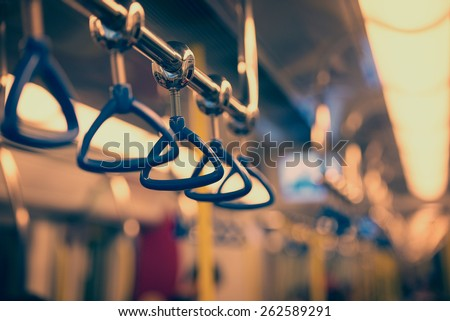 Metropolis. Handrails in a subway car in the photo instagram style. - stock photo