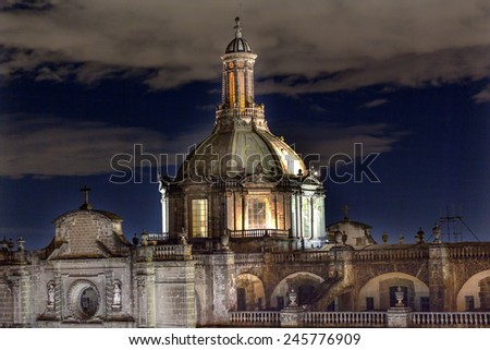 Metropolitan Cathedral Steeple Bells Statues in Zocalo, Center of Mexico City Mexico at Night - stock photo