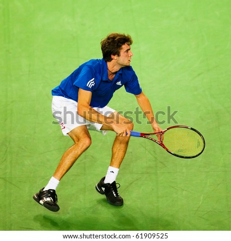 METZ, FRANCE - SEPTEMBER 26: Gilles Simon (FRA, ATP No. 41) wins the ATP Open de Moselle tennis tournament on September 26, 2010 in Metz. - stock photo
