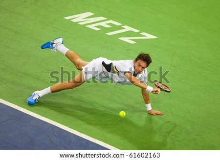 METZ, FRANCE - SEPTEMBER 23: Nicolas Mahut (FRA, ATP No. 158) is defeated by Mischa Zverev (GER, not pictured) in the 1/8 finals of the ATP Open de Moselle on September 23, 2010 in Metz. - stock photo