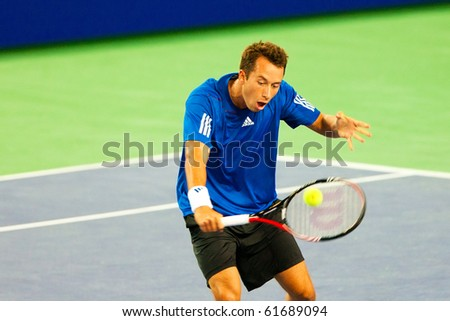 METZ, FRANCE - SEPTEMBER 24: Philipp Kohlschreiber (Germany, ATP No. 31) defeats Marin Cilic (Croatia, not pictured) in the quarterfinals of the ATP Open de Moselle on September 24, 2010 in Metz. - stock photo