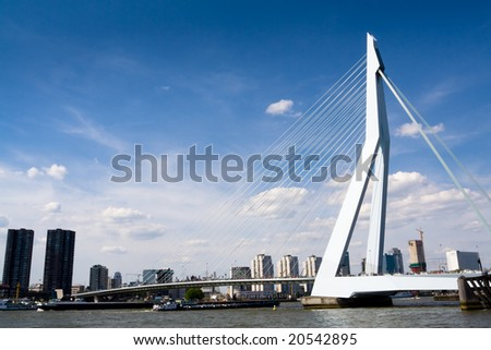 Meuse River and Erasmus Bridge in the city of Rotterdam - stock photo