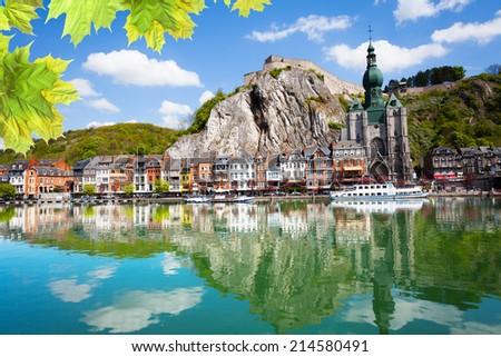 Meuse river with Collegiale Notre Dame, Belgium - stock photo