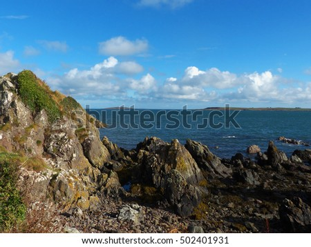 Mew Island viewed from Orlock Point in County Down Northern Ireland on a fine autumn morning