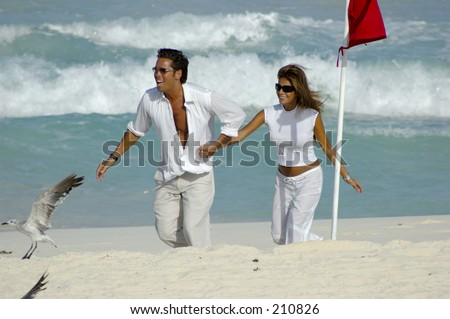 Mexican actor Roberto Palazuelos and pregnant wife Yadhira Garza de Palazuelos in Cancun. - stock photo