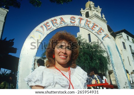 Mexican-American woman at historic Olvera Street, the birthplace of Los Angeles, CA - stock photo