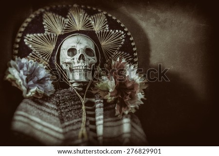 "Mexican Bandit Skeleton 3. A skeleton wearing a Mexican sombrero and a poncho, with decorative flowers in a ""Day of the Dead"" decor. Edited in a vintage film style. - stock photo"