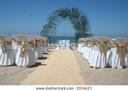 Mexican beach wedding with chairs alter and aisle - stock photo