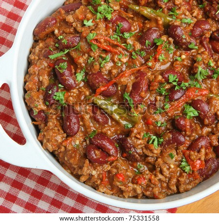 Mexican beef chili in serving dish - stock photo