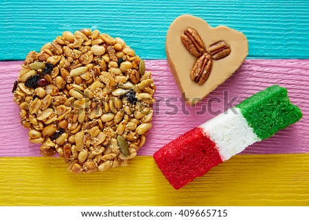 Mexican candy sweets Palanqueta cajeta heart and coconut flag - stock photo