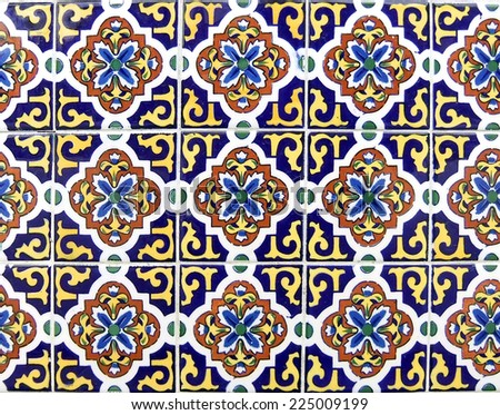 Mexican ceramic tile in dark blue and yellow, can be tiled - stock photo