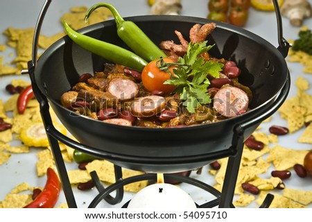 Mexican chilli w jalapenos and smoked sausage - stock photo