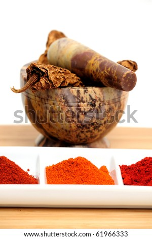 Mexican chipotle chilies smoke dried used to make salsa and meat marinades  with cayenne, New Mexico and Arbol chili powders - stock photo