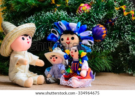 Mexican Christmas (dolls family and Christmas Tree) - stock photo