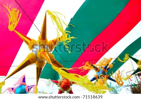 Mexican colorful  pinata in mexico with  flag background - stock photo