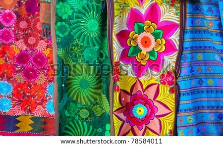 Mexican colorful serape traditional embroidery colorful fabrics - stock photo