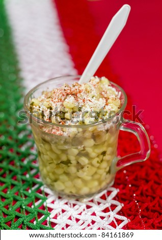 Mexican Corn Dish Known As Esquites. Mexican dish known as esquites which is corn cooked in chicken broth with epazote herb and seasoned with mayonnaise, shredded white cheese and piquin red chili.