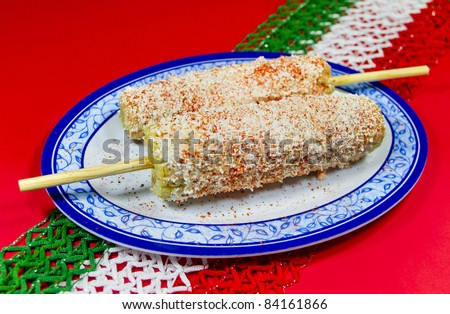 Mexican  Corn Dish. Known in spanish as Elote. Mexican corn dish with mayonnaise, shredded white cheese and piquin chili. Also known in spanish as elote.