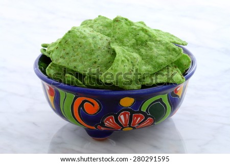 Mexican corn totopos or nacho chips on retro vintage carrara marble, perfect for all your Mexican and tex-mex recipes. - stock photo