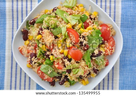Mexican Couscous Salad with tomatoes, corn and beans - stock photo