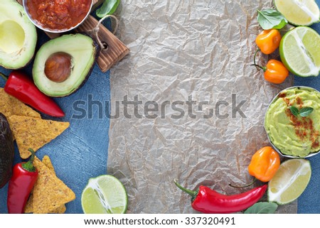 Mexican cuisine ingredients and guacamole copy space on gray - stock photo