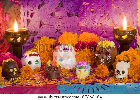 Mexican Day of the dead altar created entirely for this image session. Carefully arranged all the pieces, candles and flowers. Front View - stock photo